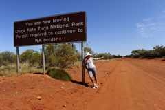 Hitchhiking Woman in Outback Royalty Free Stock Images