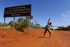 Hitchhiking Woman in Outback Stock Photography
