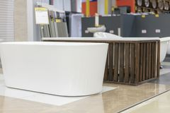 Hite bath in the building store. baths in the plumbing store. Sanitary engineering shop. White bathrooms. shop baths. Plumbing. ne. W baths. Bathroom on stock images