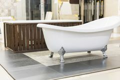 Hite bath in the building store. baths in the plumbing store. Sanitary engineering shop. White bathrooms. shop baths. Plumbing. new baths. Bathroom on royalty free stock images