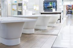 Hite bath in the building store. baths in the plumbing store. Sanitary engineering shop. White bathrooms. shop baths. Plumbing. ne. W baths. Bathroom on royalty free stock image
