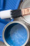Hite and blue paint in cans and brush Stock Photos