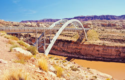 Hite Crossing Bridge Over Colorado River. The Hite Crossing Bridge is an arch bridge following Route 95 across the muddy Colorado River in Utah. Different layers Royalty Free Stock Photos