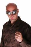 Hitman. Bald man show his fist Stock Image