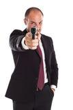 Hitman businessman. A businessman with a gun (focus on gun Royalty Free Stock Photography