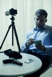 Hitman counting money. Picture of hitman counting money in dark room Royalty Free Stock Image