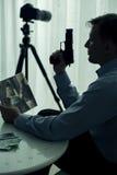 Hitman with gun. Image of hitman with gun and victim photo Stock Images