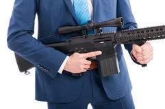 Hitman hands holding military weapon Royalty Free Stock Image