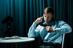 Hitman waiting for order. Picture of armed hitman with phone waiting for order Royalty Free Stock Image