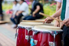 Hitting an African drums. Play on a musical instrument Drummer. Drum sticks hitting the drum. Hitting an African drums. Play on a musical instrument Drummer royalty free stock images