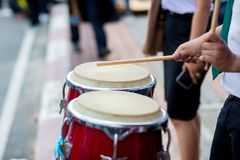 Hitting an African drums. Play on a musical instrument Drummer. Drum sticks hitting the drum. Hitting an African drums. Play on a musical instrument Drummer stock photos
