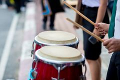 Hitting an African drums. Play on a musical instrument Drummer. Drum sticks hitting the drum. Hitting an African drums. Play on a musical instrument Drummer royalty free stock photography