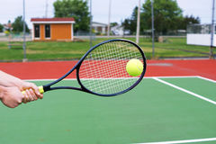 Hitting a backhand at tennis. Player hands on tennis racket hitting a back hand volley Stock Images