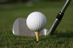 Hitting the ball. Hitting a golf ball on the tee Royalty Free Stock Photos