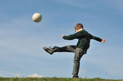 Hitting the ball Stock Photography