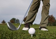 Hitting the ball with a club. Stock Photography