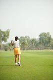 Hitting ball with a club Royalty Free Stock Photos