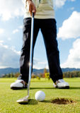 Hitting the ball at golf Royalty Free Stock Image