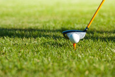 Hitting ball with the golf club Stock Photos