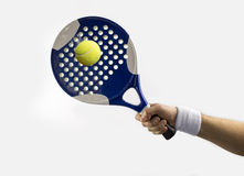 Hitting a ball. Hand with a tennis racket hitting a ball paddle Royalty Free Stock Photos