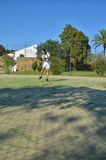 Hitting a ball in a tennis match Royalty Free Stock Images