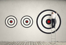 Hitting bigger business target stock illustration