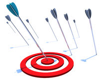 Hitting the Bulls Eye. One arrow hits the bulls eye while several others miss the mark Stock Images