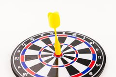 Hitting center yellow dart shot in business success concept Stock Photo
