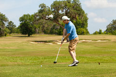 Hitting the Driver off the Tee Box Royalty Free Stock Images