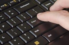Hitting Enter on computer keyboard Royalty Free Stock Images