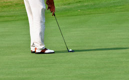 Hitting the golf. Image of golf player, is hitting a golf on the lawn Royalty Free Stock Images