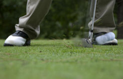 Hitting golf ball. With wedge Royalty Free Stock Images