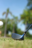 Hitting a golf ball Royalty Free Stock Images