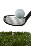 Hitting a golf ball off a tee Stock Images