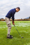 Hitting a golf ball Stock Images