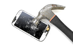 Hitting with hammer to phone screen on white background royalty free stock image