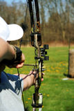 Young man shooting a bow Stock Images