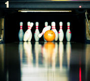 Hitting the skittles. Bowling. Orange ball hits the skittles Stock Image