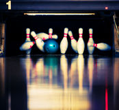 Hitting the skittles. Bowling. Blue ball hits the skittles Royalty Free Stock Photography