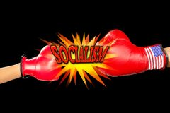 Hitting Socialism Hard. Wirh fist and boxing gloves stock photo