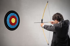 Hitting the Target. A businessman is hitting a target Stock Photography