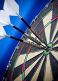 Hitting the target. Three darts in the bulls eye royalty free stock images