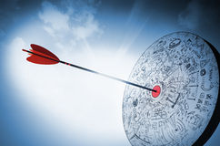 Hitting the target. Target hit in the middle by arrow Stock Images