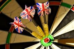 Hitting Targets. Close up of three darts hitting a bulls eye royalty free stock images