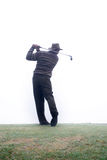 Hitting th ball. Driving the golf ball Royalty Free Stock Photo