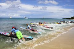 Hitting the water on Coconut Cup Paddle board race. 10K Race Stand Up Paddle Board Race starts as the athletes hit the water in Fredriksted, St Croix, US Virgin Stock Photo
