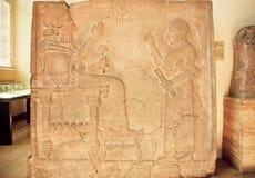 Hittite art, relief with King Bar-Rakib sitting on the throne, 750 BC Stock Images