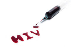 HIV由在白色被隔绝的背景的血液拼写了 免版税库存图片
