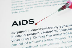 Hiv aids. Syringe with blood lying on a paper Royalty Free Stock Photo