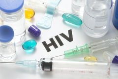 HIV. Concept photo with syringes, vials, pills, and catheter Stock Photo